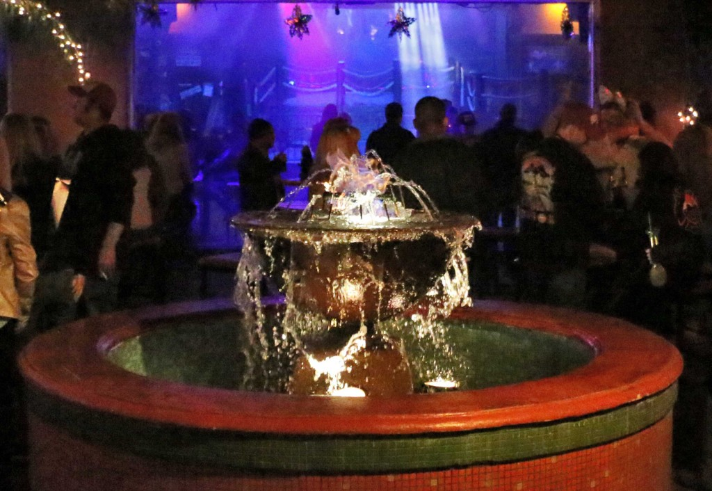 The Flaming Fountain located in the brick courtyard at The Beach on Bourbon